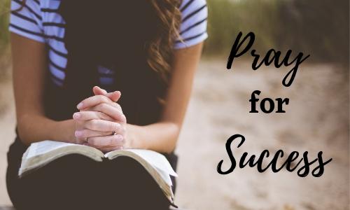 women with open bible praying