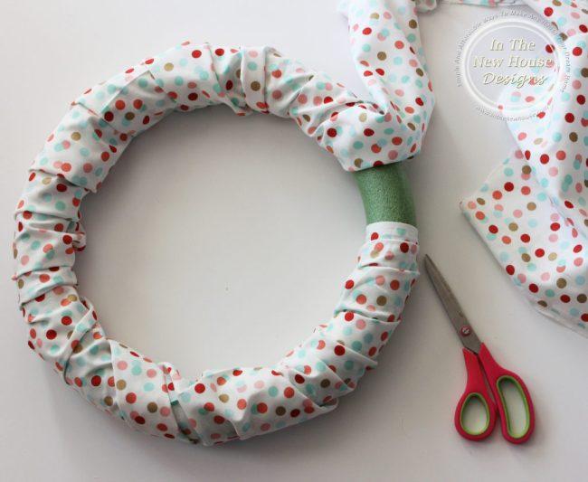 Wrap fabric around foam wreath