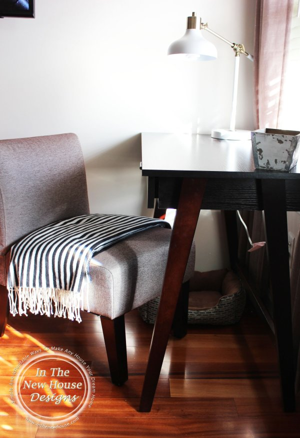 Writing desk in front of window