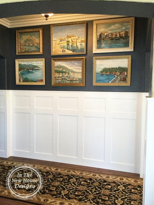 Cozy entryway with gallery art wall and white board and batten