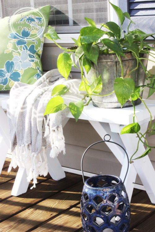 Utilize various textures to make a porch feel cozy