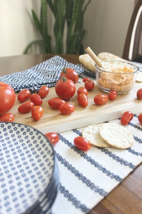 Use red tomatoes and blue appetizer plates for a festive party snack