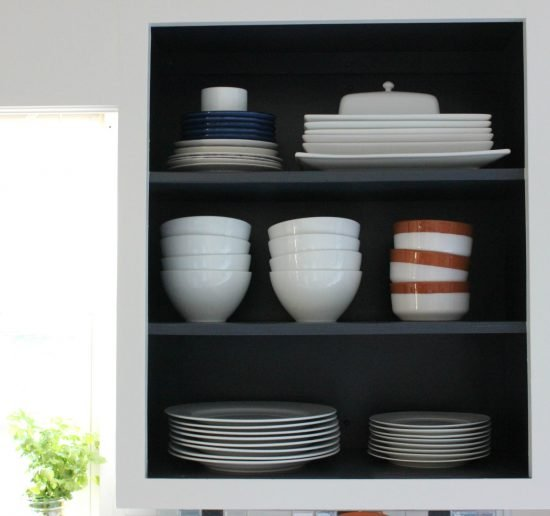 Open Shelving In Kitchen with Dark navy paint and white dishes