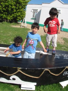 boys playing on a boat at the lighthouse