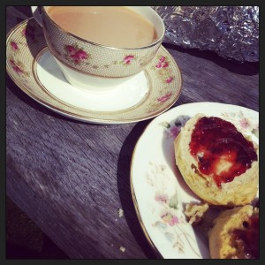 tea in china tea cup, and scones with jam