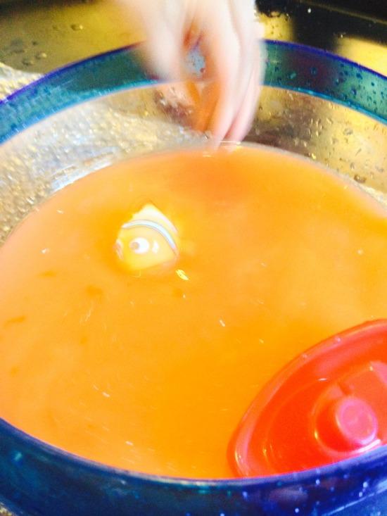 water play making orange water