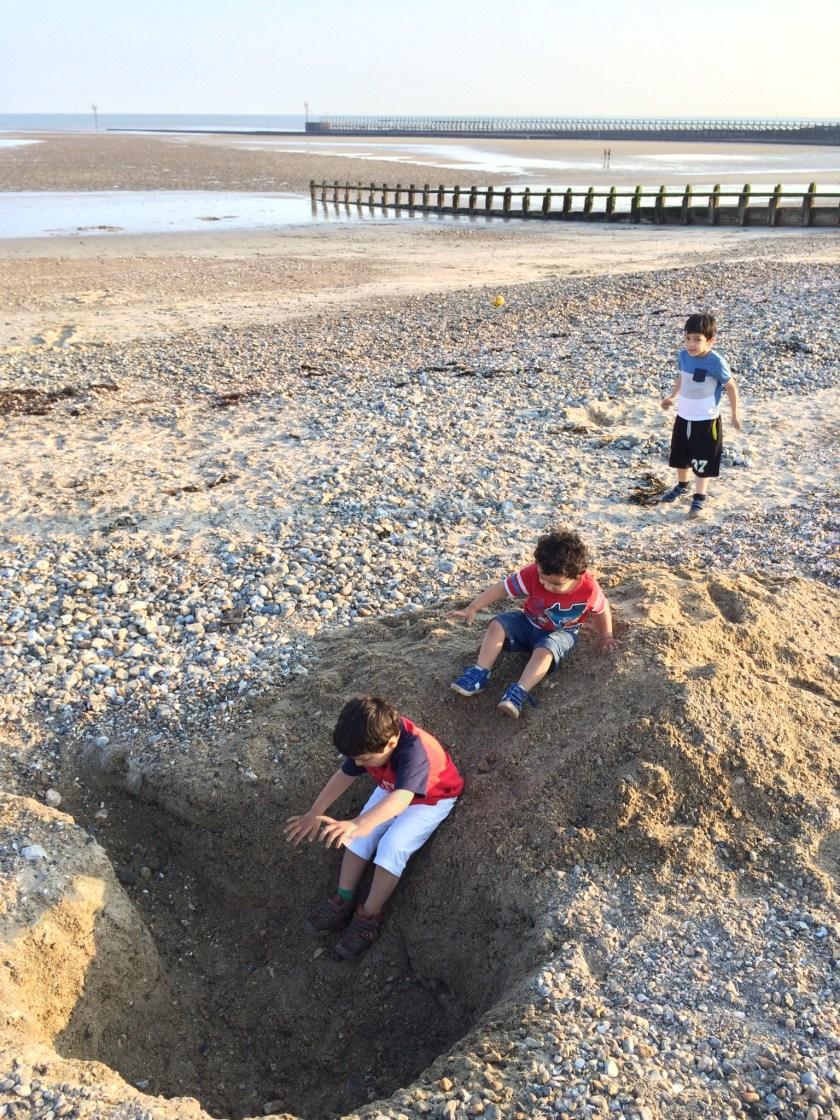 make a sand slide at the seaside