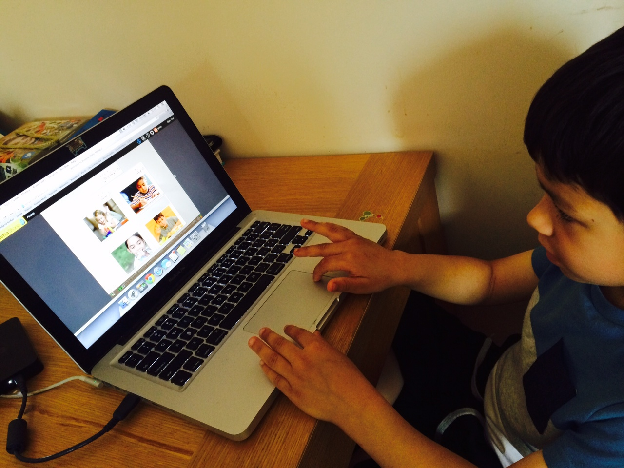 Child Learning Arabic With Rosetta Stone