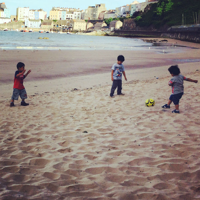 playing football on tenby beach