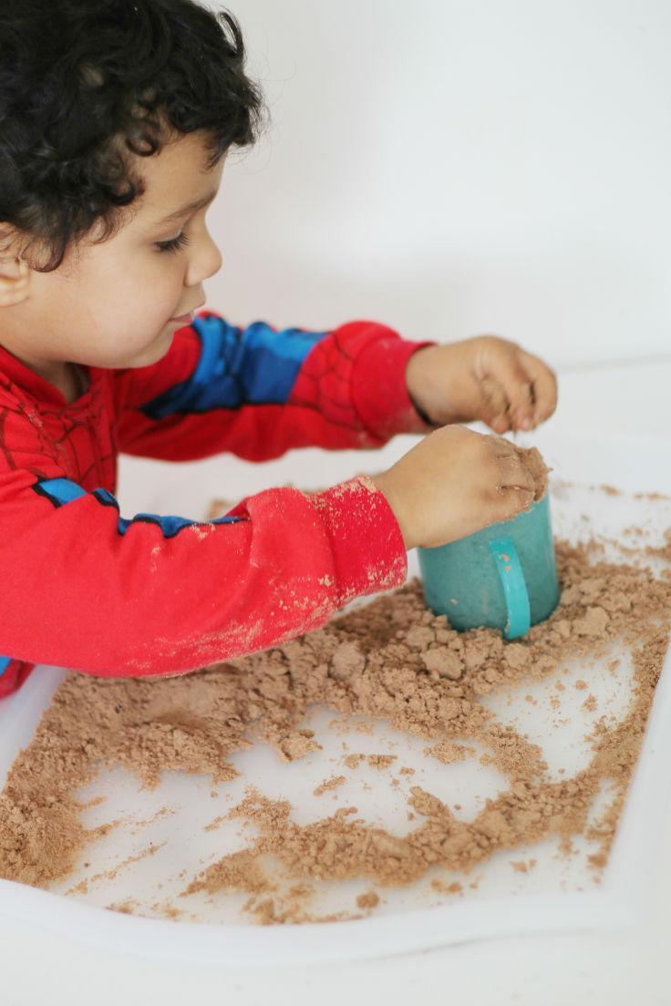 making chocolate cloud dough sand castles