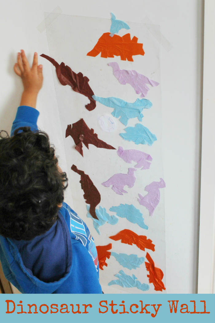 Dinosaur themed sticky wall activity for toddlers