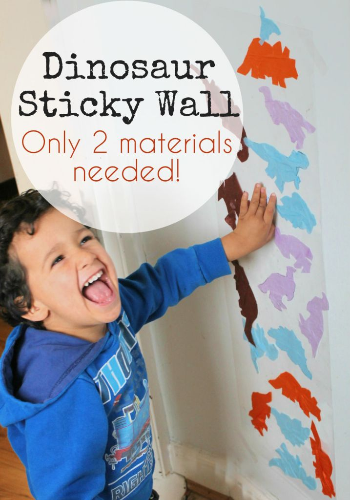 Dinosaur sticky wall toddler activity with only 2 materials needed. Great rainy day activity!