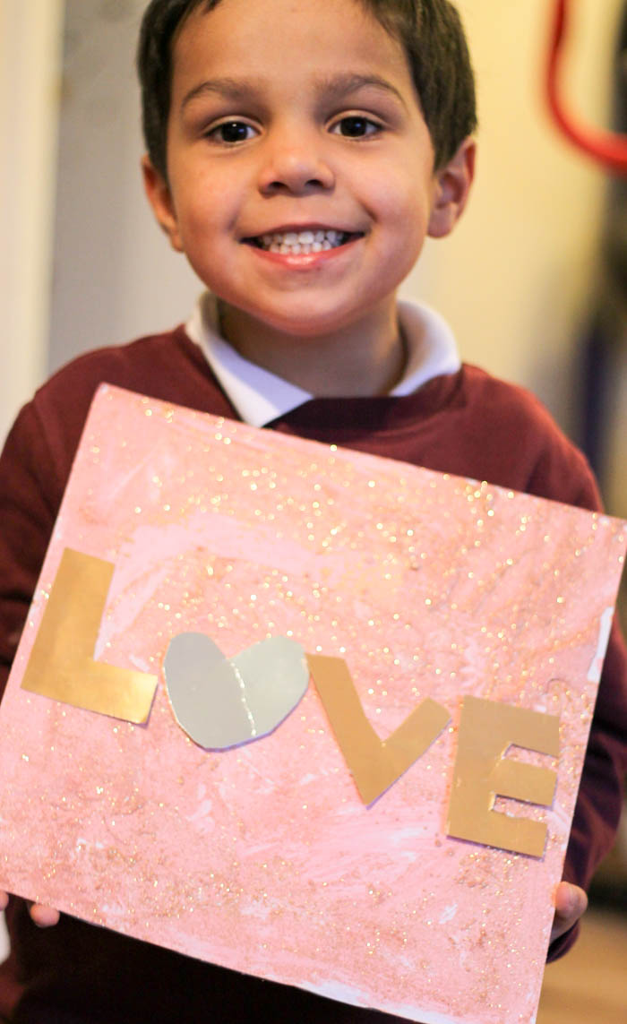 "Kid made ""love"" process art canvas for Valentines day"