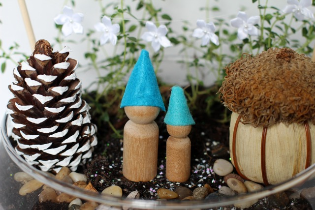 gnome home winter fairy garden in a terrarium