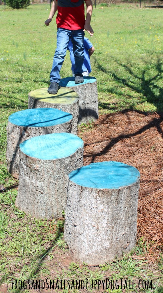 coloured tree stumps for outdoor play