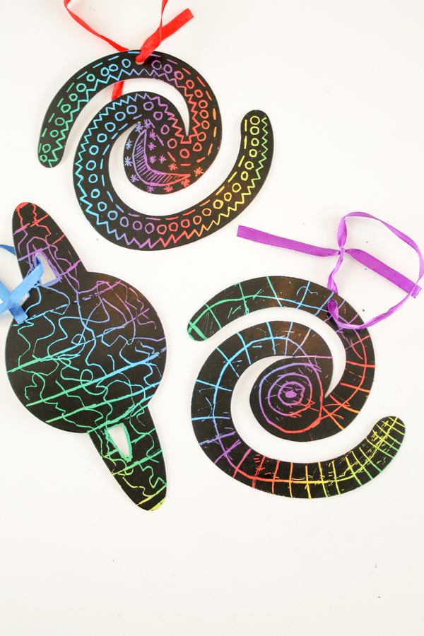 Outer space scratch art with patterns craft for kids. Great for a solar system topic, or a space birthday party
