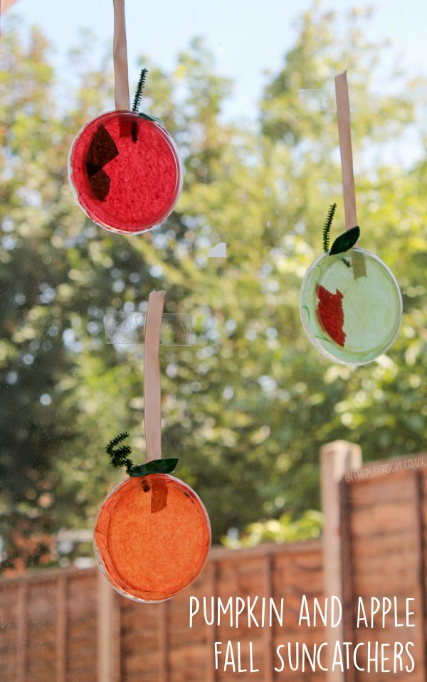 Pumpkin and apple tissue paper sun catchers craft to brighten up your windows for fall. Fun and easy autumn craft for kids