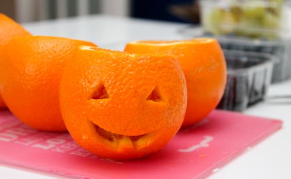 carving orange jack o lanterns