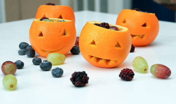 Orange jack o lantern fruit cups. Super simple, quick and easy healthy Halloween party idea for kids