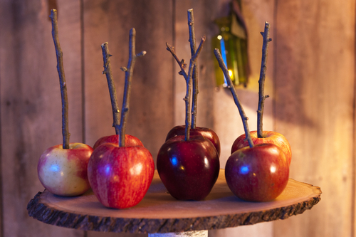 Making Candy apples with sticks