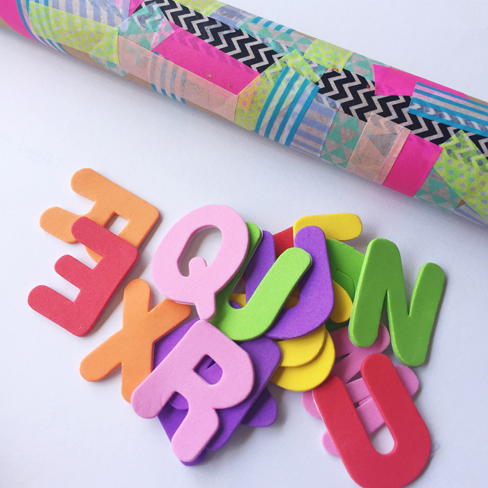 making a diy rain maker with washi tape and letters
