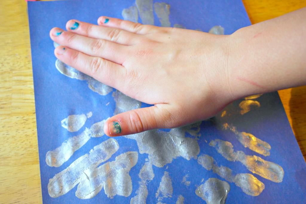 making handprint snowflakes