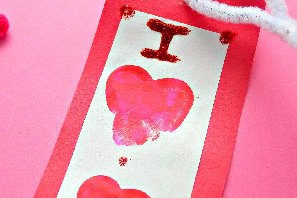 making thumb print heart book mark