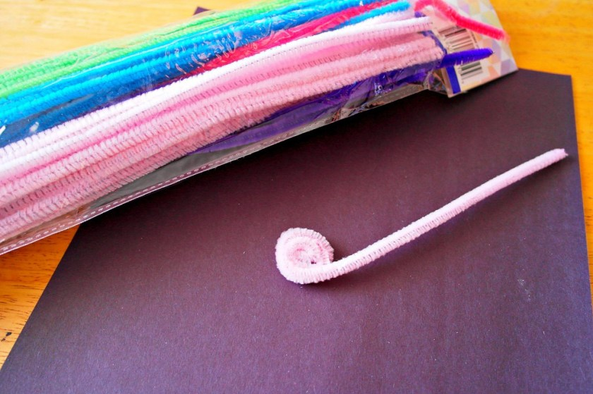 rolling pipe cleaners to make flower craft