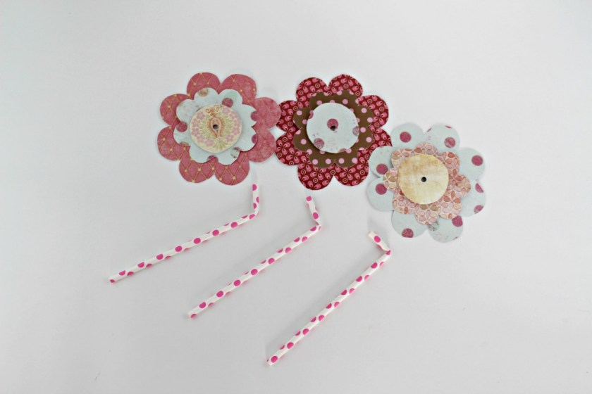 paper flowers and straws