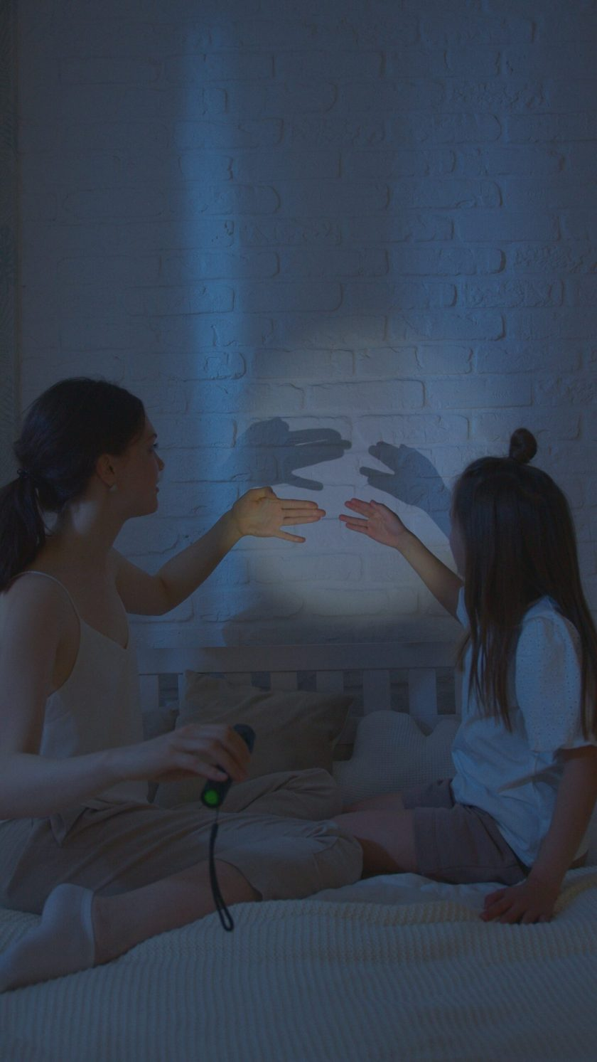 making shadow puppets with hands
