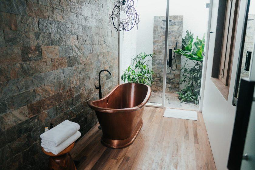 bathroom with brass bronze mental bath