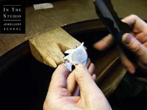 Student-Filing-Cast-Silver-at-the-bench