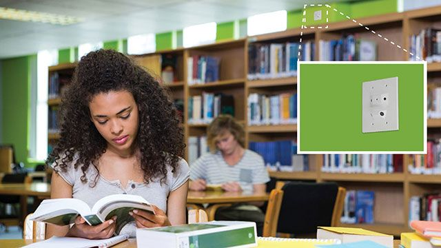 girl studying in college library with guardian security