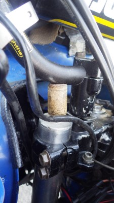 Wine corks can be used to fix all sorts of things. Here we have a cork sealing a damaged fork cap, preventing the bike from spraying me in the face with fork oil at every bump (it happened a few times!).