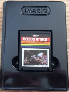 atari_8bit_computer_demon_attack_cart_in_holder