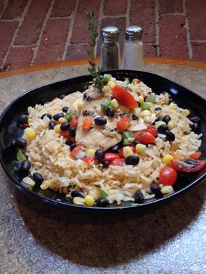Waterworks | Zesty Lime Chicken served with corn & black salsa and spiced rice