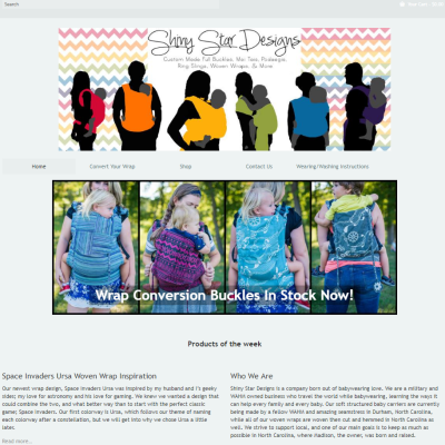 Screenshot of a babywearing website with six hand drawn models, each wearing a solid color carrier, forming a rainbow, and four white caregivers wearing blue and purple carriers. Beneath those images are two paragraphs about the company.