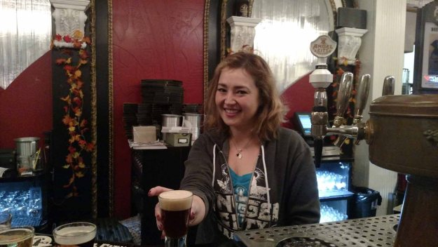 Angel City Brewing bartender serving Imperial Irish Red