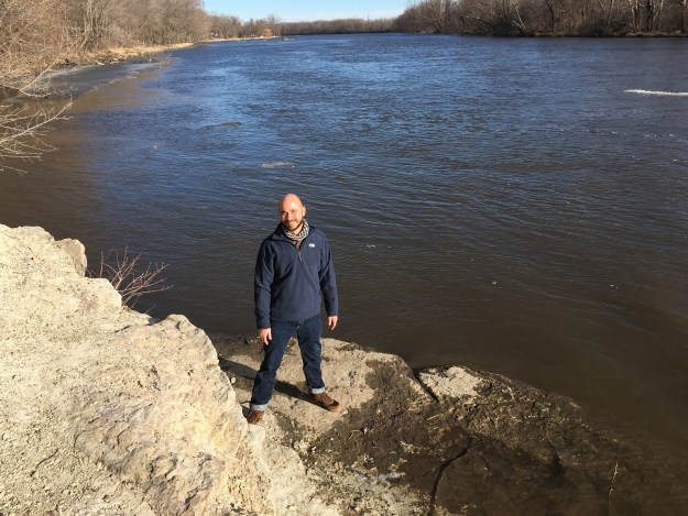 Standing next to the Rock River.