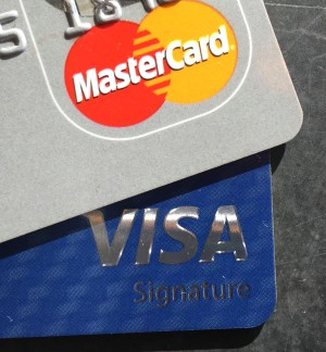visa and mastercard logos on edge of credit cards