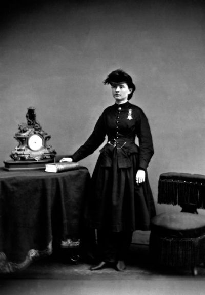 Mary Walker - Woman in long dark dress, dark hair, pale skin and medal pinned to breast