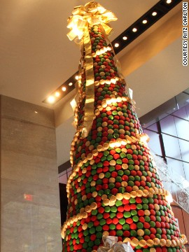 The hotel pastry team at the Ritz-Carlton hotel in Charlotte, North Carolina, took 58 hours to create this 8,000-cakelet Christmas tree  And were paid in macaroons