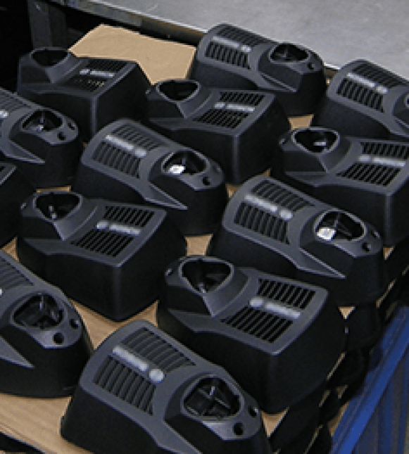 In-house plastic injection molding for production of charger casings.