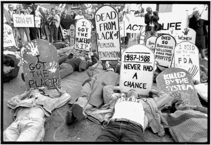 Protesters with makeshift tombstones demonstrate.