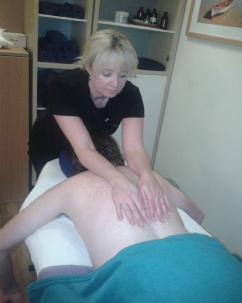 Vivienne performing a massage