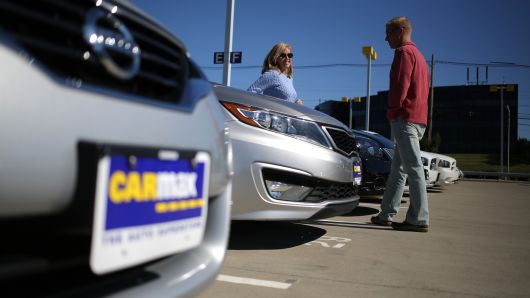 Customers shop for used vehicles at a CarMax dealership in Lexington, Kentucky.