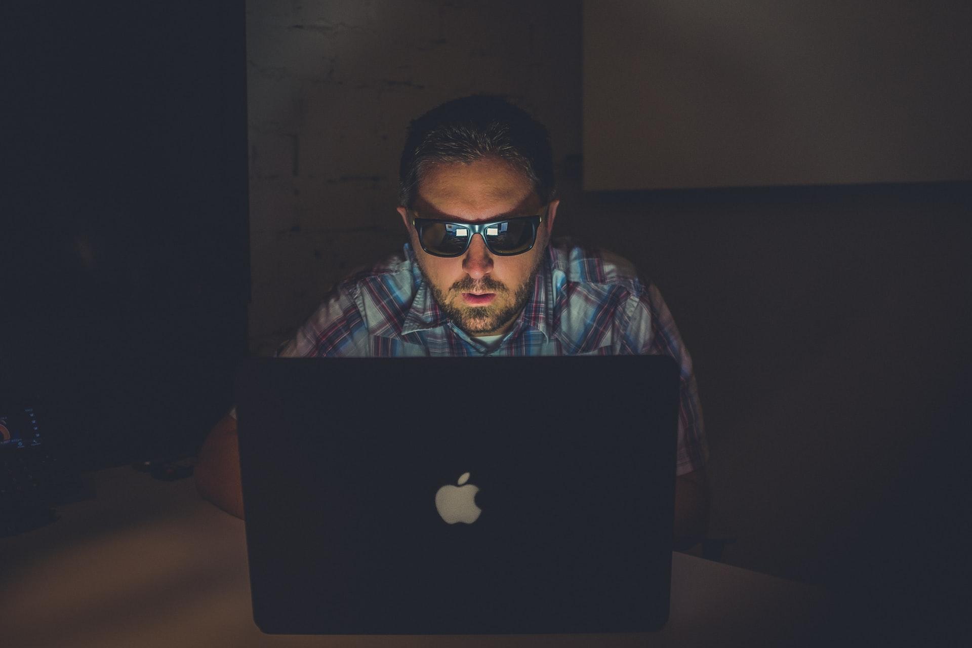 Hacker hacking an investor website