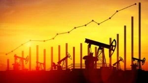 Illustration of oil pump jacks against a sunset sky background to represent oil and gas stocks