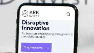 A close-up of the Ark Invest homepage on a smartphone screen.