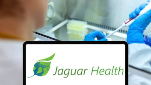 The Jaguar Health logo on a tablet in front of a doctor.